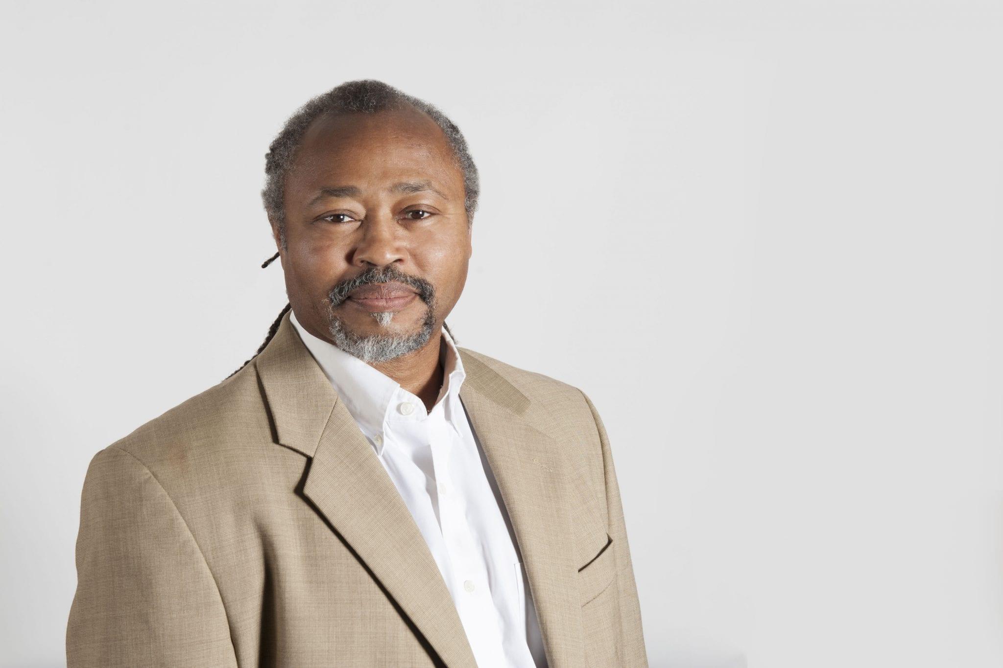Portrait of Michael Bradford behind a gray backdrop