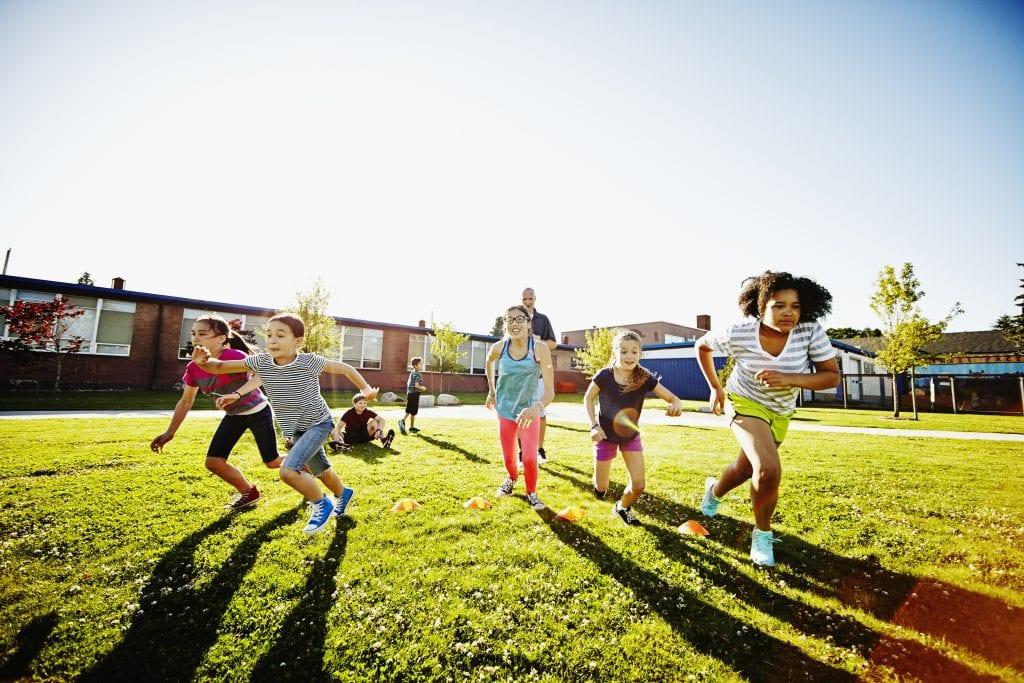 Kids running on playground